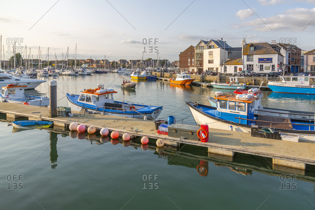 September 10, 2020: View of harbor boats and quayside houses, Weymouth, Dorset, England, United Kingdom, Europe