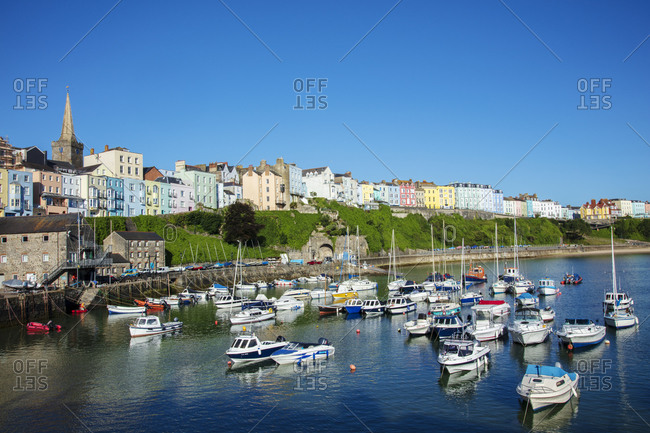View of the town center and fishing boats in the harbor, Tenby, Pembrokeshire, Wales, United Kingdom, Europe