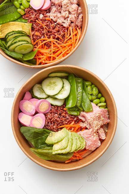 Healthy green vegetarian buddha bowl lunch with eggs, dark rice, spinach, avocado and beans on a light gray background, copy space. Top view. Clean healthy food.