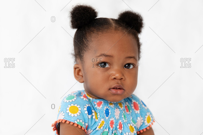 Close up of cute baby girl with hair buns