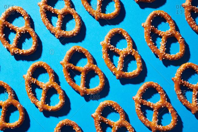 Arrangement of pretzels on a blue background