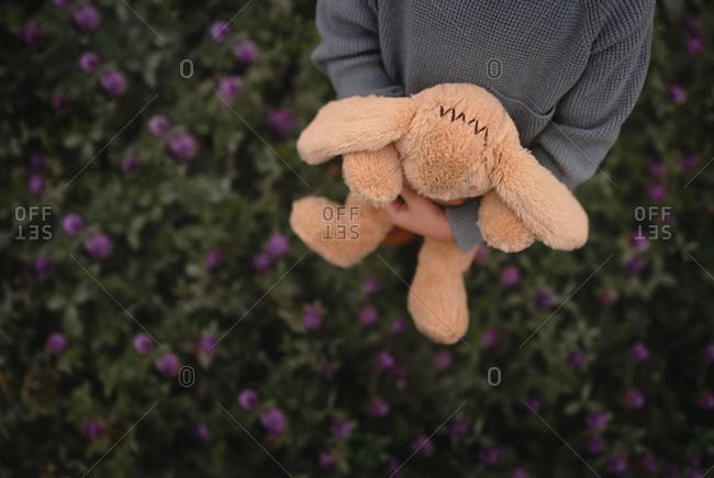 Faceless shot of child holding stuffed animal