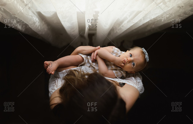 Overhead shot of baby girl in mother�s arms