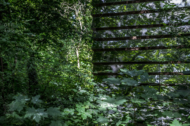 July 14, 2020: Detail of the Spiegelhaus, a glass-covered building among trees in Treptower Park, Berlin, Germany