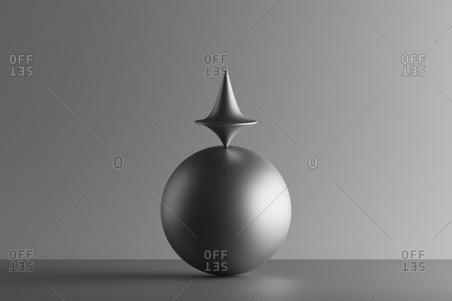Three dimensional render of metallic top spinning on top of sphere