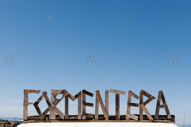 Formentera text against clear blue sky during sunny day