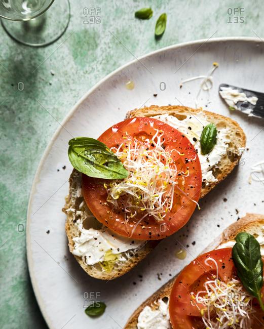 Tomato bruschetta with basil and cress