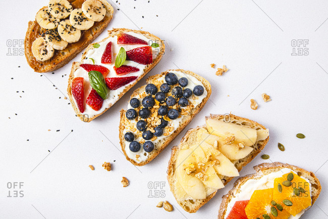 Studio shot of five slices of bread with fresh fruits