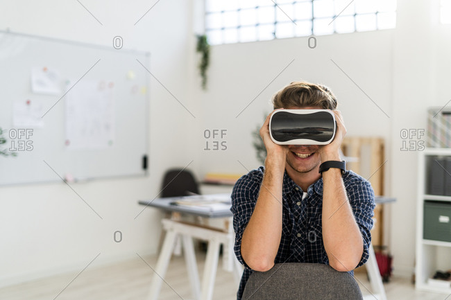 Man using visual simulator while sitting on chair at office