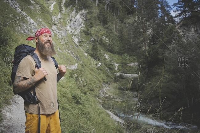 Bearded man wearing bandana standing in forest- Otschergraben- Austria