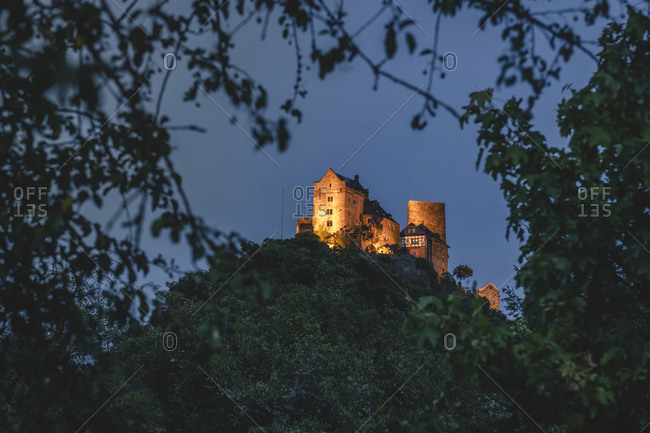 Germany- North Rhine-Westphalia- Oberwesel- Schonburg castle standing on top of hill in Rhine Gorge at night