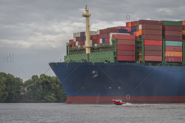 Germany- Hamburg- Container ship on Elbe river