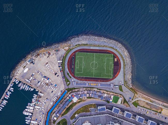 Russia- Primorsky Krai- Vladivostok- Aerial view of harbor and coastal soccer field