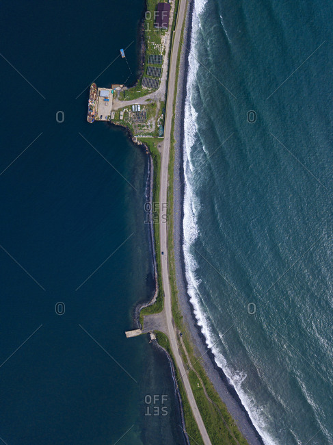 Russia- Primorsky Krai- Zarubino- Aerial view of coastal road stretching along narrow strip of land