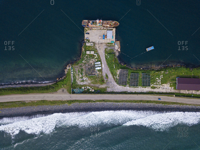 Russia- Primorsky Krai- Zarubino- Aerial view of coastal village and road stretching along narrow strip of land