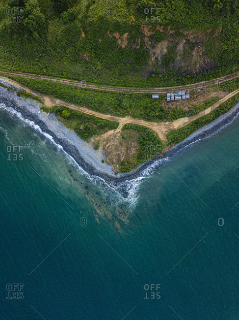 Aerial view of railroad tracks stretching along coast of Sea of Japan