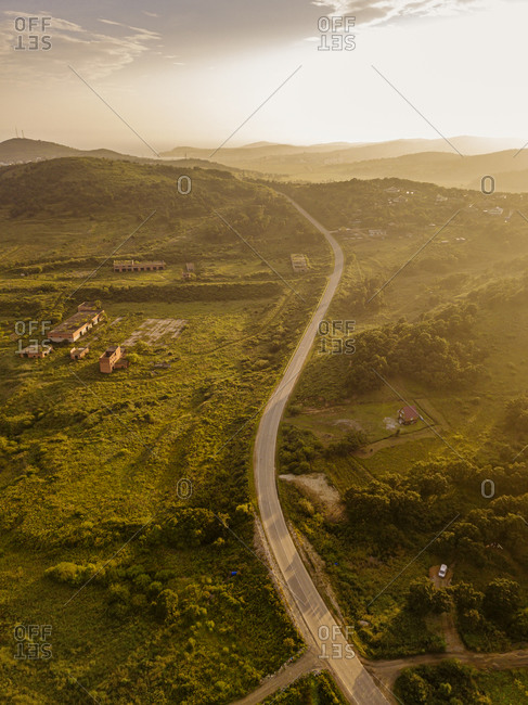 Russia- Primorsky Krai- Zarubino- Aerial view of road stretching along hilly landscape at sunset