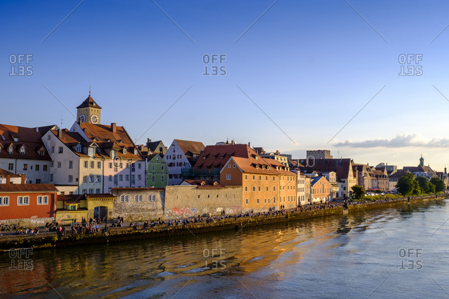 June 11, 2020: Germany- Bavaria- Adelsdorf- Regensburg- Danube river and riverside old town houses at dusk