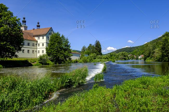 Germany- Bavaria- Pielenhofen- River Naab and Pielenhofen Abbey in summer