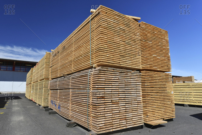 Planks stacked in a lumberyard