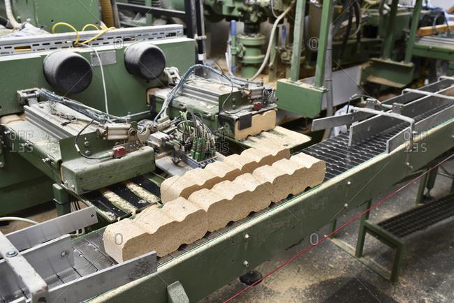 Wood being processed in lumberyard