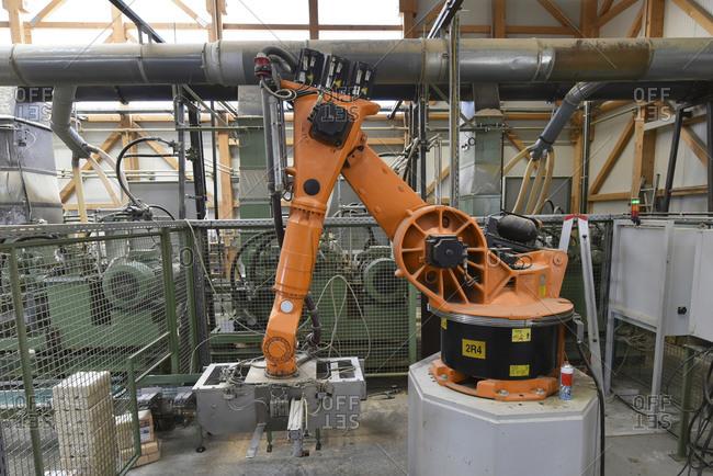 Robotic arm operating in modern lumberyard