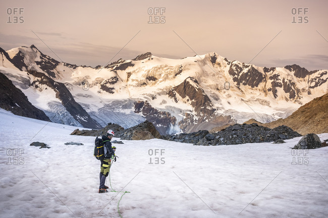 Mature man standing on snowcapped mountain against sky- Stelvio National Park- Italy