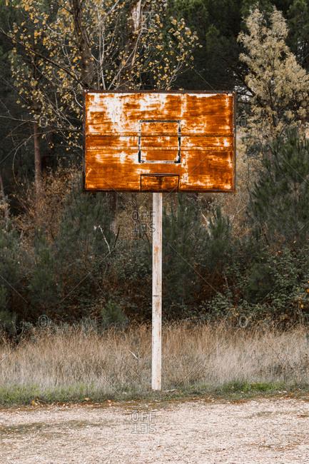 Old rusty basketball hoop outdoors