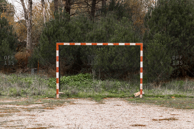 Goal on small abandoned sports field