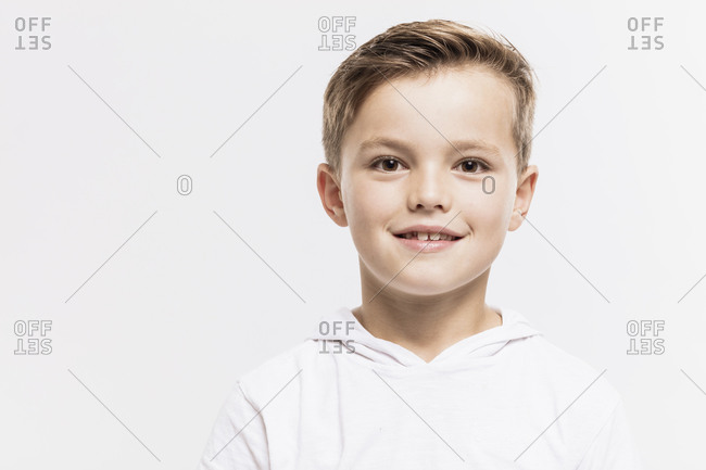 Close-up of cute boy against white background