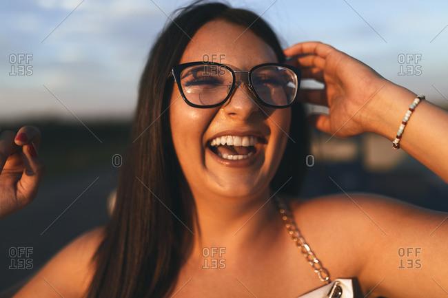 Beautiful woman laughing during sunset