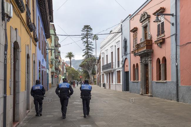 January 20, 2020: three police officers on Calle san Agustina, san Cristóbal de la laguna, tenerife, canary islands, Spain