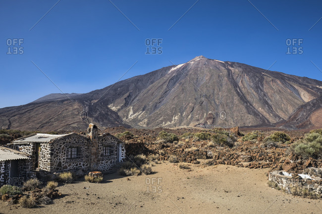Old sanatorium in the el teide national park with a view towards picot del teide (3718 m), unesco world heritage, tenerife, canary islands, Spain