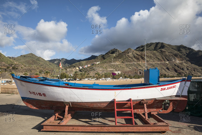 January 25, 2020: fishing boat in front of the anaga mountains, san Andres, tenerife, canary islands, Spain