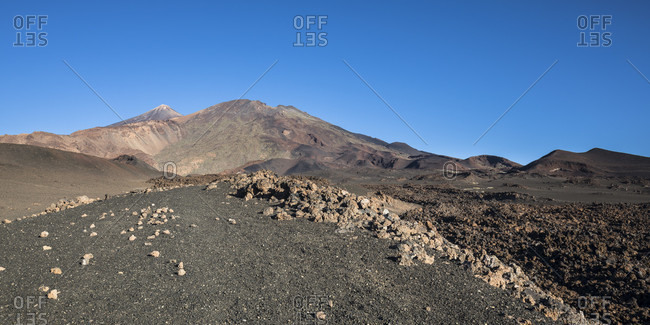 Volcanic landscape with a view of the volcanoes picot del teide (3718 m) and picot viejo (3135 m), el teide national park, unesco world heritage, tenerife, canary islands, Spain