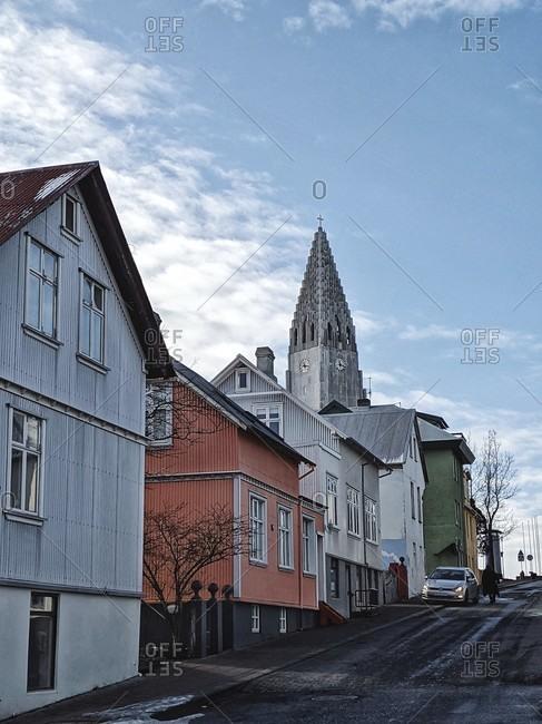 March 17, 2020: hallgrímskirkja protrudes between houses, reykjavik, iceland