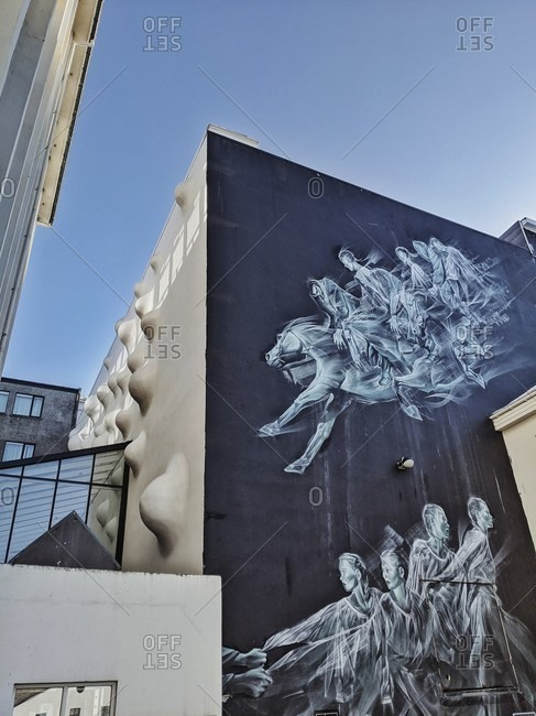 "March 17, 2020: ""pale green ghosts"", street art by artist john gent in iceland's capital city reykjavik"
