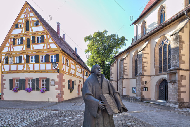 September 4, 2019: old Latin school, martin Luther statue, st. andreas church, house facade, altstadt, weissenburg, franconia, Bavaria, Germany