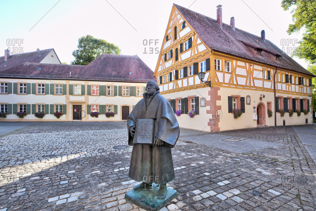 September 4, 2019: martin Luther statue, square, old Latin school, house facade, altstadt, weissenburg, franconia, Bavaria, Germany