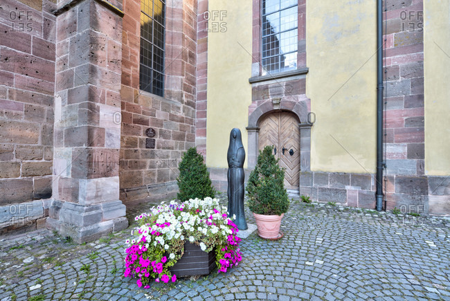 September 3, 2019: statue, st. walburga, liebfrauenmunster, church, entrance, house facade, wolfram-eschenbach, franconia, Bavaria, Germany