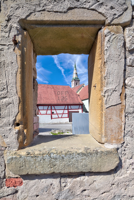 View through old wall, church tower, house facade, half-timbering, wolfram-eschenbach, franconia, Bavaria, Germany