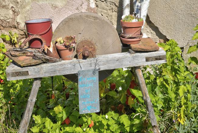 House facade, grinding stone, succulents, garden, still life, wolfram-eschenbach, franconia, Bavaria, Germany