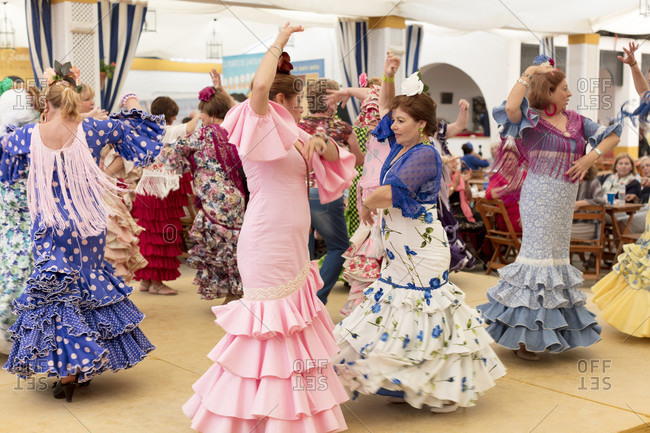 April 28, 2016: flamenco, dancers, casetas, marquees, la feria de primavera, festival, traditional costume, tradition, culture, customs, el Puerto de Santa maria, andalusia,