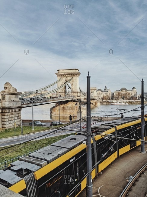 December 15, 2019: view of budapest's chain bridge as a tram passes by, hungary