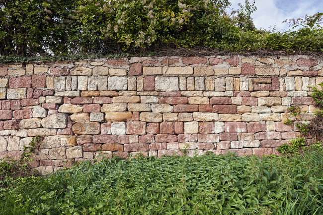 Red sandstone dry stone wall in the vineyard