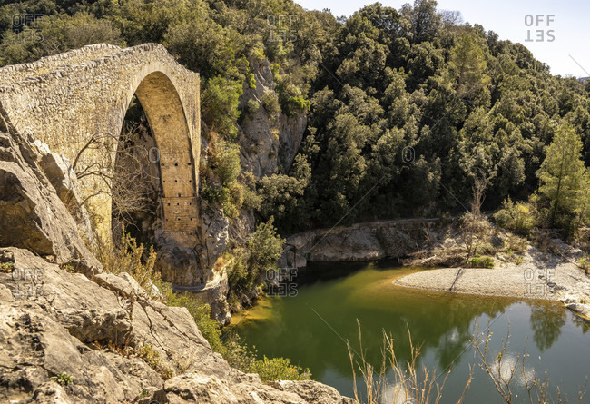 Europe, Spain, catalonia, girona province, la garrotxa, montagut, medieval bridge over the llierca river