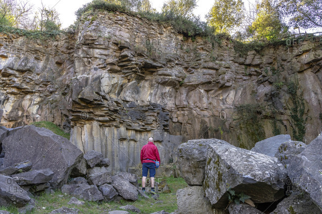 Europe, Spain, catalonia, gerona province, la garrotxa, hikers in front of a petrified lava flow at sant joan les fonts