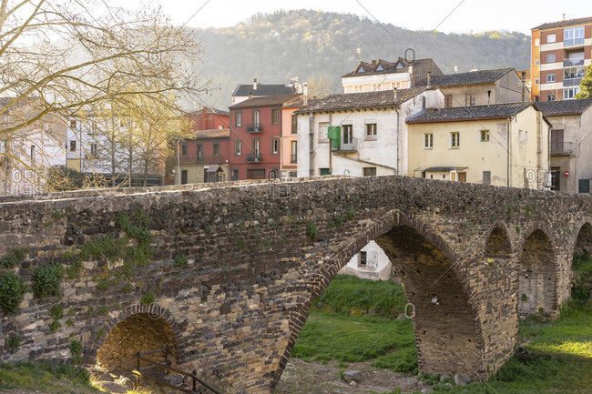 Europe, Spain, catalonia, girona province, la garrotxa, view of the medieval stone bridge in sant joan les fonts