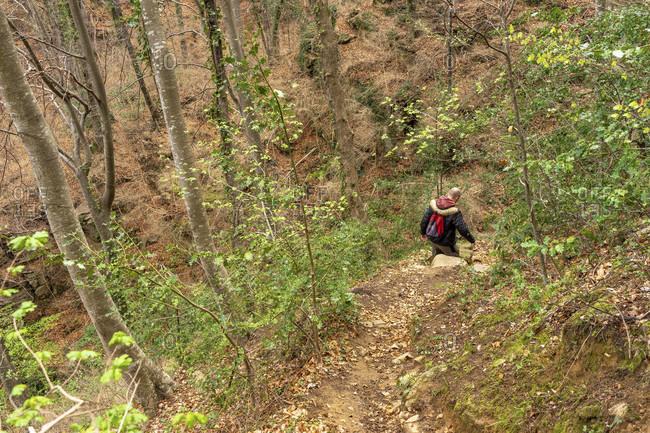 Europe, spain, catalonia, girona province, garrotxa, santa pau, hikers in the descent from the sanctuary of santa maria de finestres