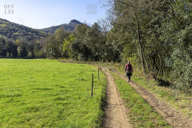 Europe, spain, catalonia, girona province, garrotxa, santa pau, hikers on the barons de santa pau hiking trail